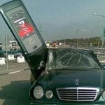 cell phone crashes into car