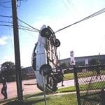 accident car hanging from telephone wires
