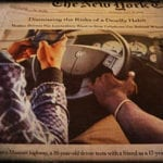 Texting while driving on the news (photo by David Sugden)