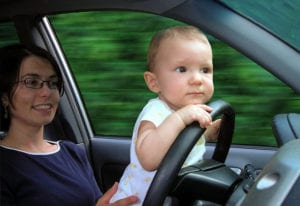 baby on the driver's wheel