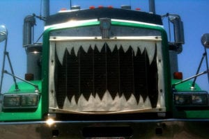 photo of teeth painted on large truck grill
