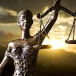 Lady Justice with scales to decide personal injury lawsuits