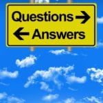 Personal Injury Questions Answers Sign against blue sky