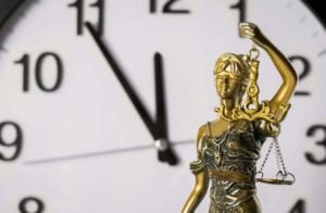 Clock and Lady Justice Depicting West Virginia Statutes of Limitations