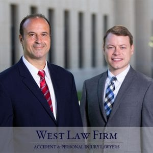 WV Injury Lawyers Brooks West and David Dobson in front of the WV Capitol