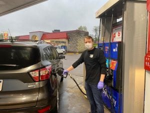 Personal Injury Lawyer David Dobson pumping gas for healthcare workers