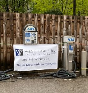 West Law Firm Sign at Free Gasoline for Healthcare Workers Event