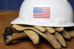 West Virginia worker's hard hat, gloves and hammer