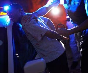 West Virginia Police Office Arresting Man Against Cop Car