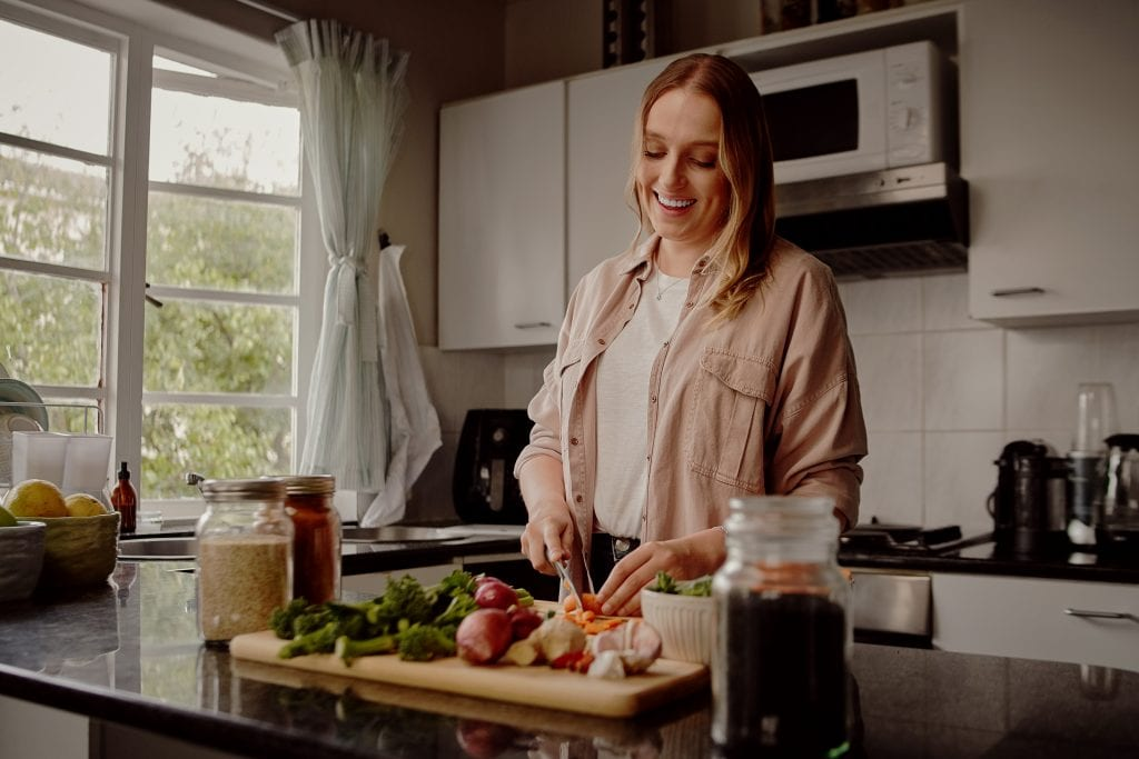 Woman enjoying weight loss from eating fresh fruit and vegetables after being injured in an accident
