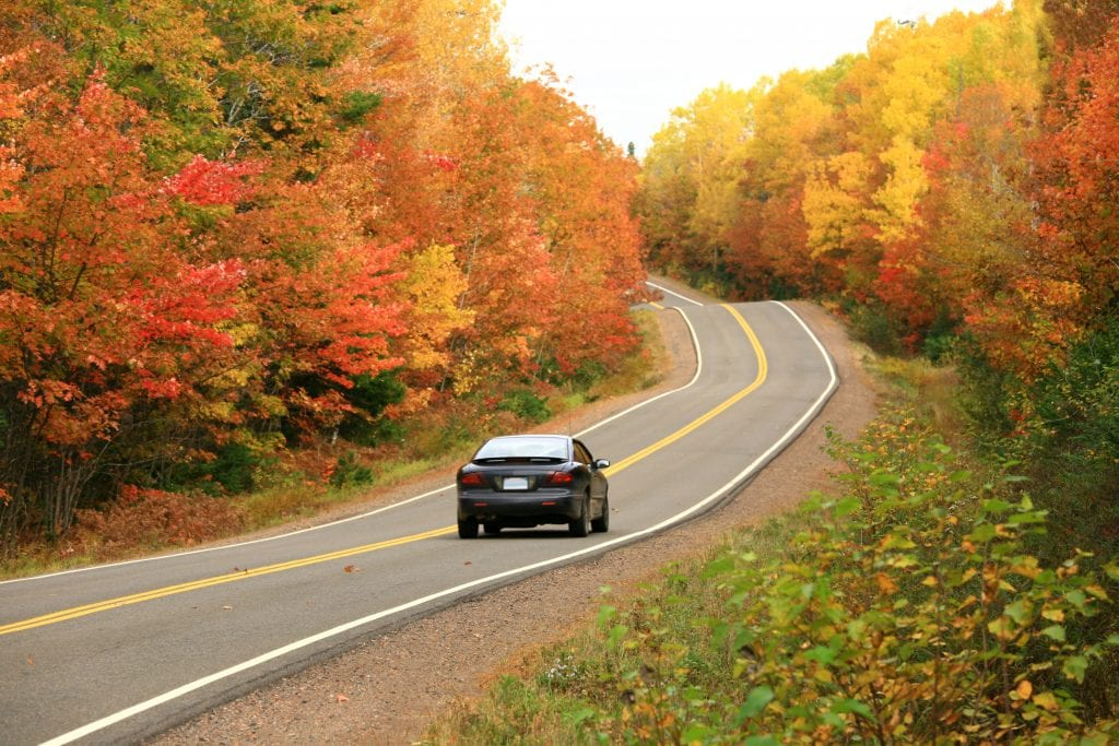 Car driving on dangerous West Virginia rural road in the fall