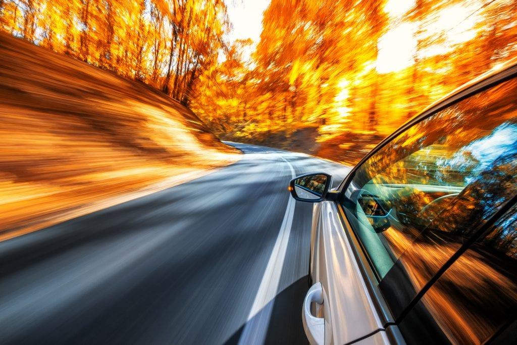 Car speeds on West Virginia rural road.