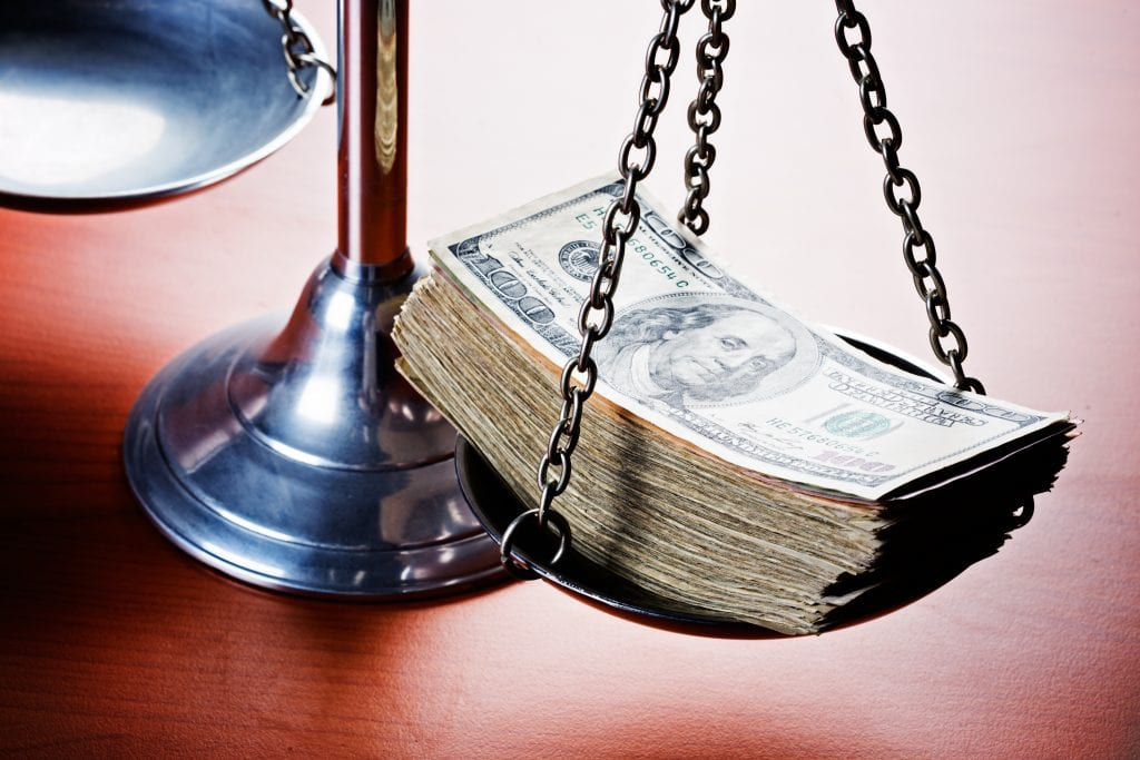 Scales of Justice Weighing Dollars to Determine the Value of a Personal Injury Case