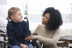 child with cerebral palsy working with therapist
