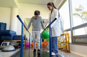 a child in rehabbing in physical therapy after a car accident